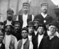 Photograph of foreman and workers
