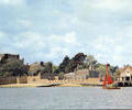 Sailing dinghy in front of Brownsea Castle