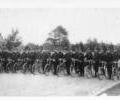Policemen parading with  bicycles.